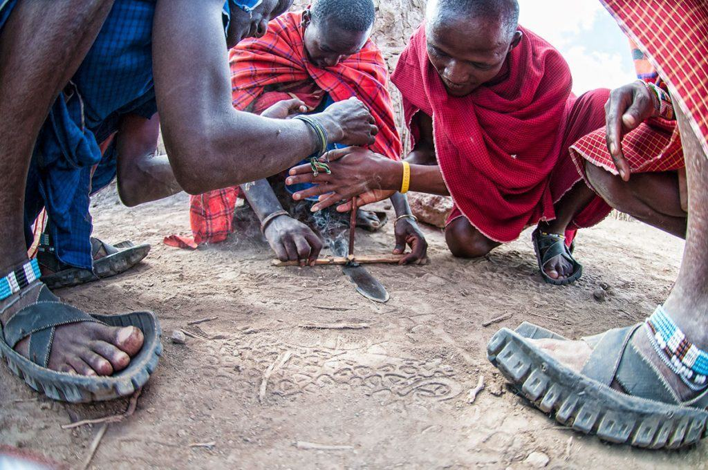 Maasai starting fire