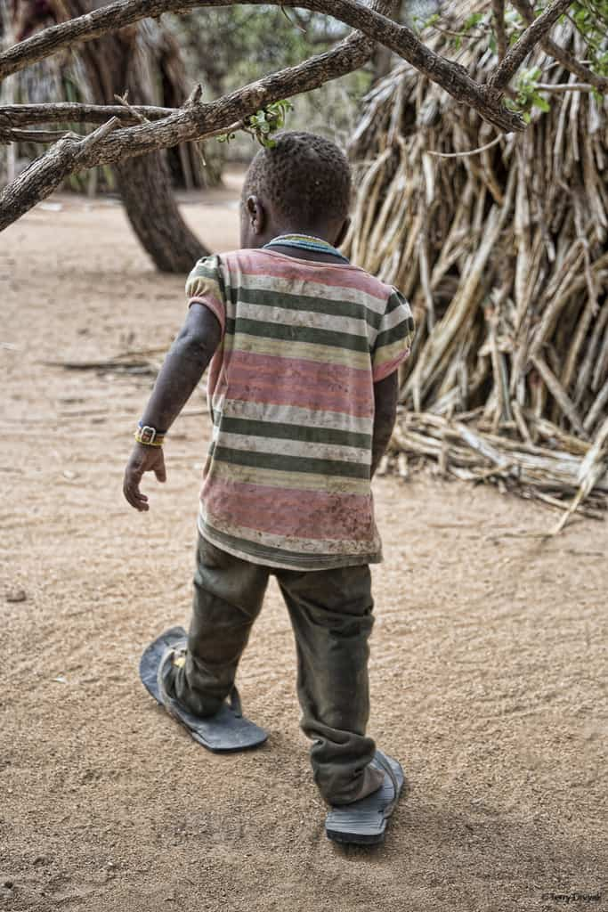 Hadza Boy in oversized Sandals