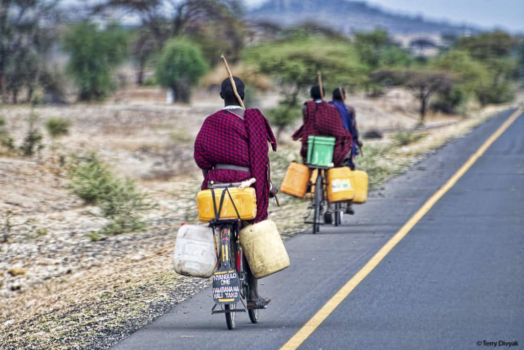 Massai getting water in bikes